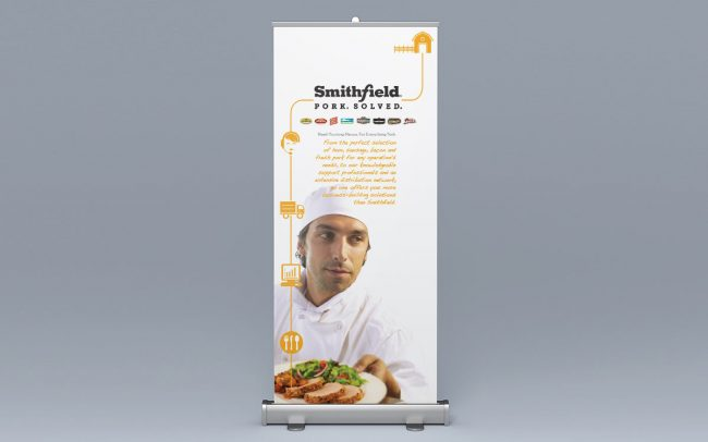 A branded pullup banner for a corporate trade show created by Foodmix for the client Smithfield that features a chef.