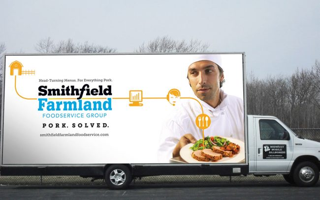 A truck with a large billboard promoting Smithfield that is used for trade shows and events.
